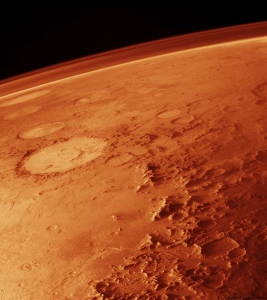 The Red Planet from space, featuring Galle, the happy face crater
