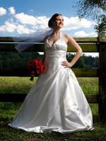 bride standing in field