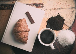 Croissant and coffee with book
