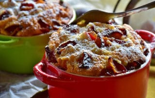 Plum cakes in casserole dishes