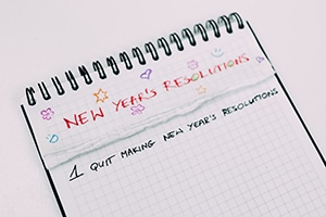 Notepad with list of New Year's resolutions